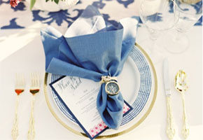Blue and gold tablesettings. Photo by Chrisman Studios