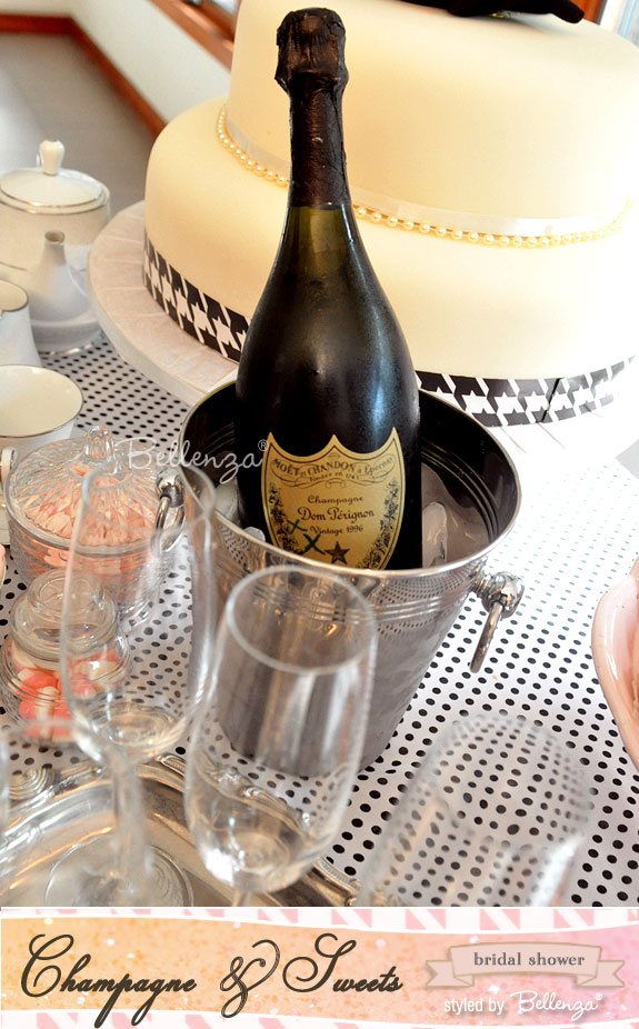 Silver iced bucket of Dom Perignon for a sweets and champagne bridal shower theme