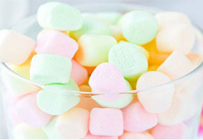 Pastel candies in pink, yellow, and mint green.