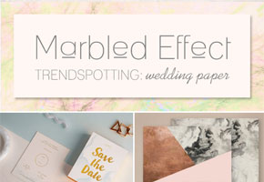 A curation of marbled wedding invitations, save-the-dates, and place cards by Bellenza