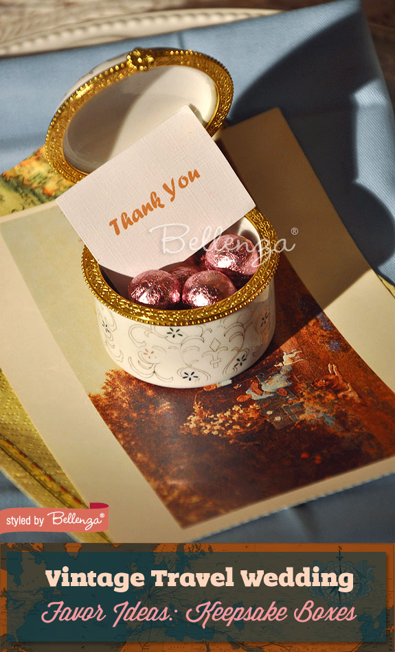 Vintage-style keepsake boxes with pink-foil chocolates for guests resting on a place setting.
