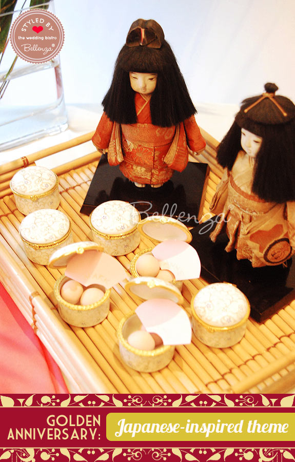 Traditional Japanese dolls displayed on a favor table for guests.