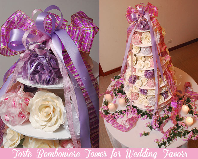 Assembling the tower with pink, lilac, and white rose favor bags.