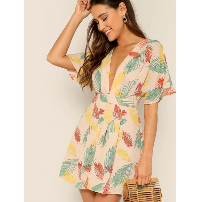 Plunging neck open back tropical dress