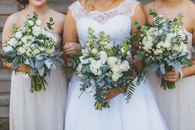 Image provided by Bwedding Invitations. Bridesmaids bouquets in classic white roses.
