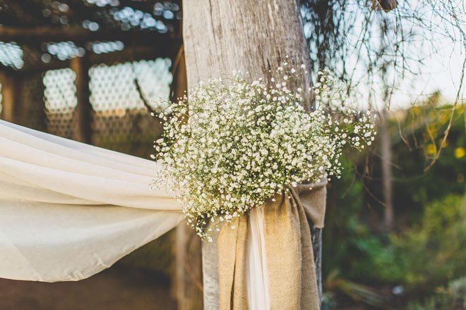 Image provided by Bwedding Invitations. Baby's breath decor.