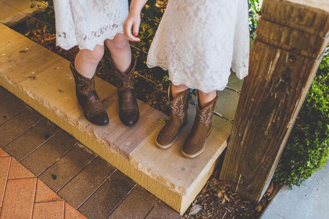 Another delightful contrast: the flower girls' lace dresses and cowboy boots!