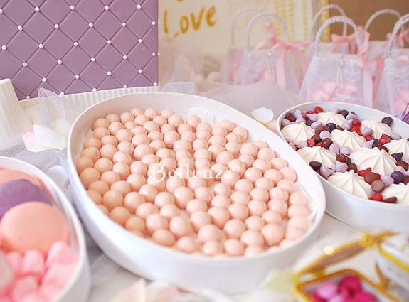 Pink bonbons for guests at a Parisian tea party.