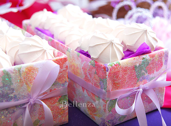 Mini meringues served in floral boxes.