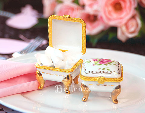 Mini footed porcelain box with gold trimmings and rose embelishments
