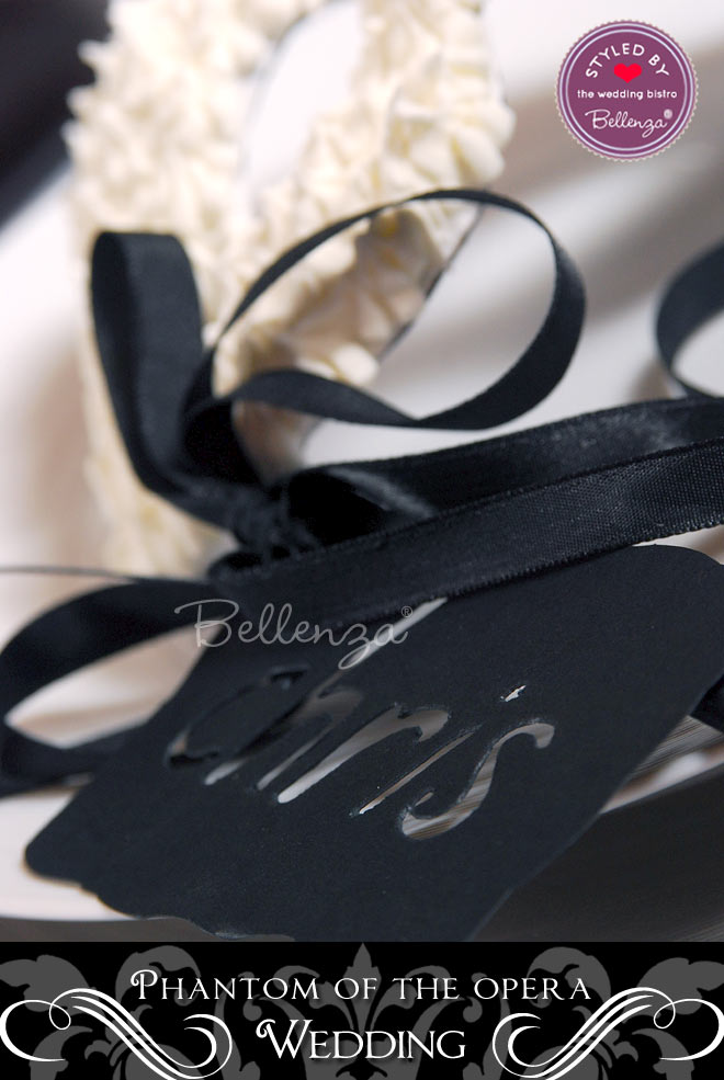 A black velvet mask serves as a place card for guests.