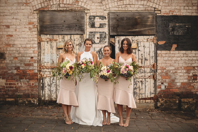 Bridesmaids in neutral dresses.