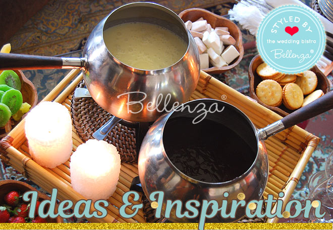Silver fondue pots of ipping sauce for breads, fruits, and vegetables // Bellenza