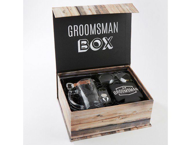 Grooms crate box with glass mug, a can sleeve, a bottle opener, sunglasses, and a cigar cutter