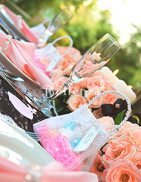Roses themed favors with tulle purses