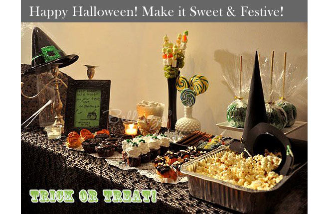 Halloween sweets and snacks table for a bridal shower with popcorn, cupcakes, eclairs, candy apples with green sprinkles, and marshmallow pops.
