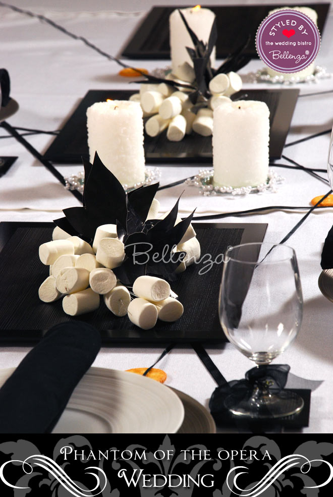 Black and white table decor elements from white centerpieces to black accents.