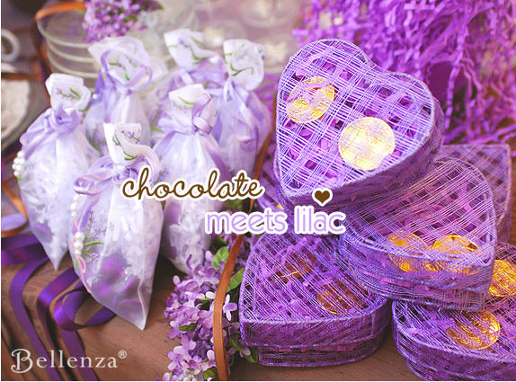 Purple favor boxes with chocolates coins
