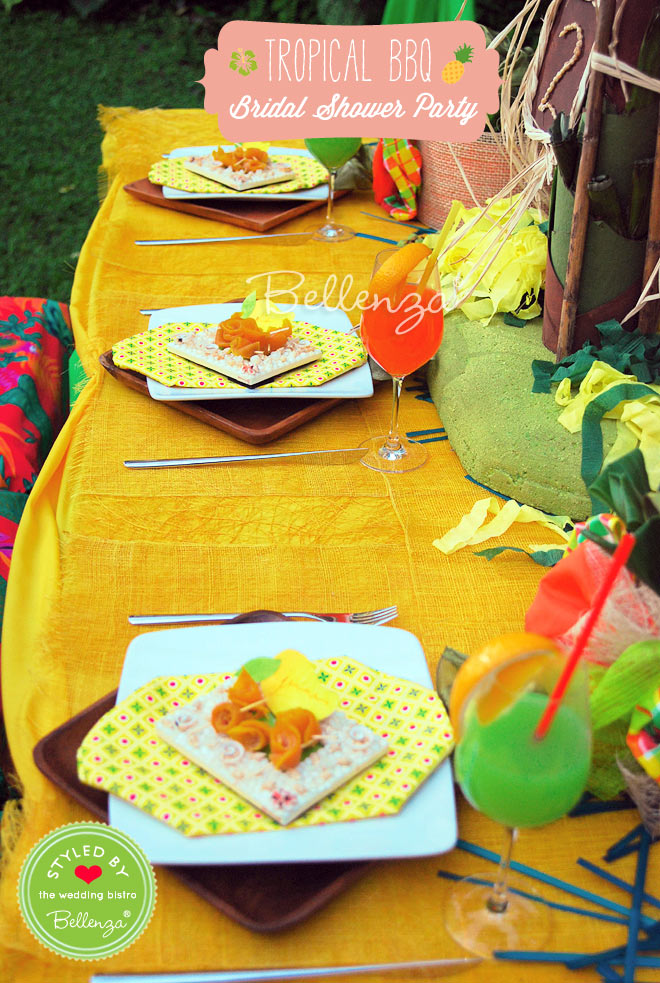 Tropical tablescape for a couples wedding shower.