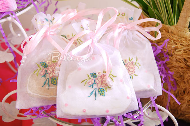 Wedding cake cookie in white rose organza favor bag