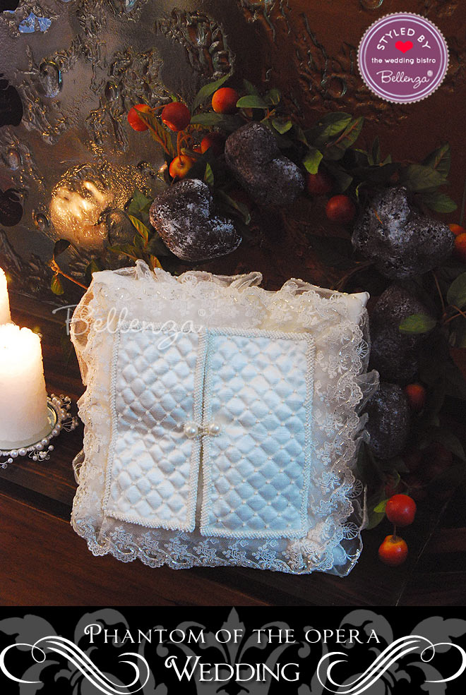 A vintage ring pillow doubles up as a ceremony display.