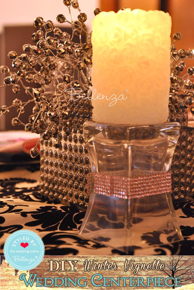 White candle on glass vase stand.